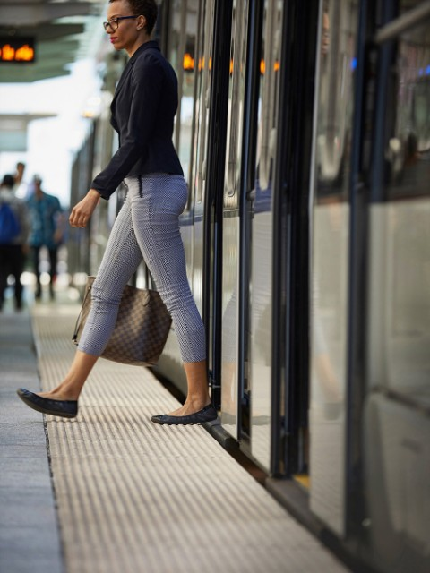 Woman on Metro platform in Houston Central Business District